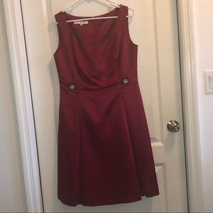 Formal red dress with jewel detailing